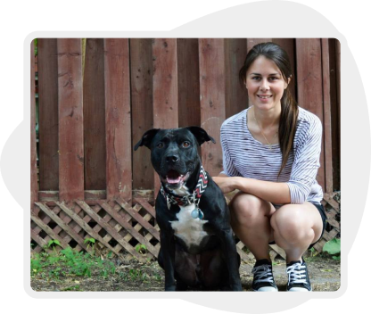 Picture of a woman crouching next to her dog