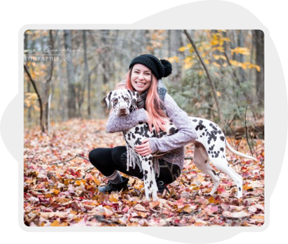 Picture of a woman crouching and hugging her dog